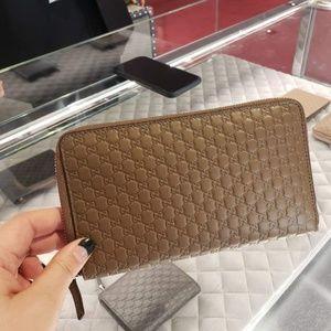 Gucci Leather Microguccissima XL Zip around Wallet